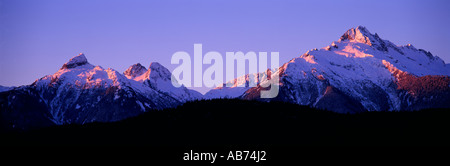 Alpenglow on the Tantalus Mountain Range ('Coast Mountains') near Whistler and Squamish in Southwestern British - Stock Photo