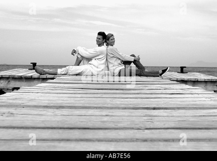 Couple on pier - Stock Photo