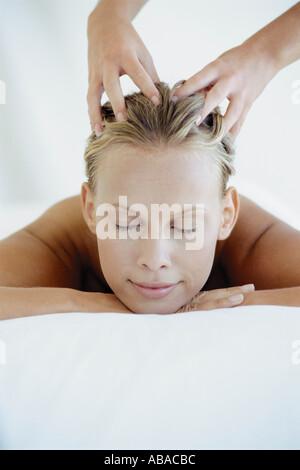 Woman receiving head massage - Stock Photo