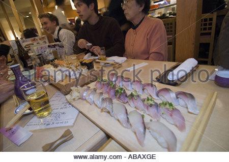 Sushi Restaurant At Tsukiji Fish Market - Stock Photo