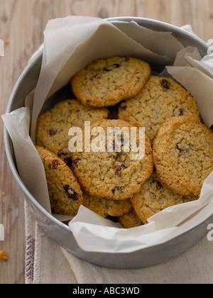 Fruit cookies in metal tin - Stock Photo