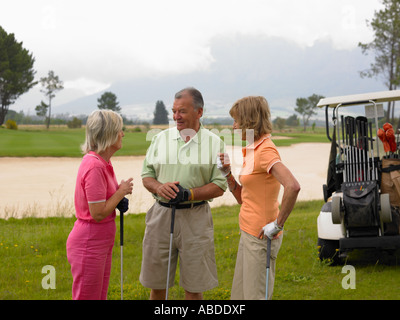 Golfers chatting - Stock Photo