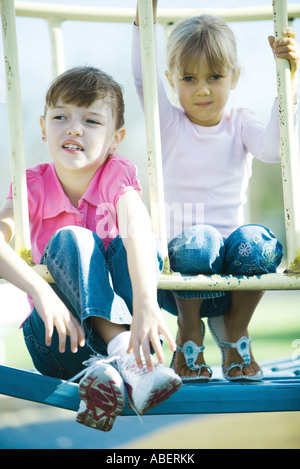 Children on playground equipment - Stock Photo