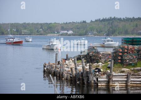 Lobster boats moored along the Maine coast - Stock Photo