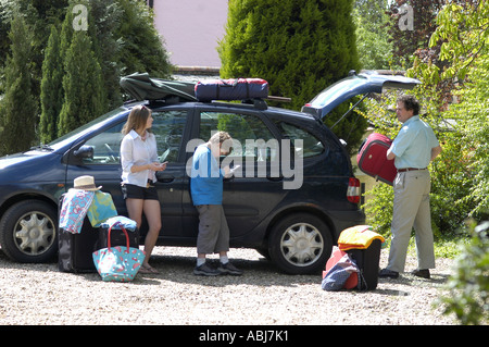 packing to go on holiday - Stock Photo