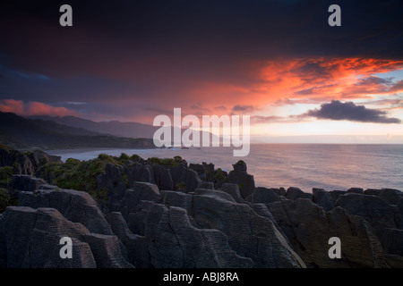 A storm brewing over the Punakaiki Rocks better know as the Pancake Rocks on New Zealand, West Coast - Stock Photo
