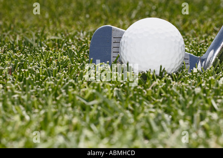 Close Up Of Golf Club With Ball On Fairway - Stock Photo