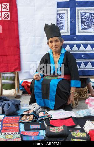Hmong Woman Vendor At Handicraft Market, Luang Prabang - Stock Photo