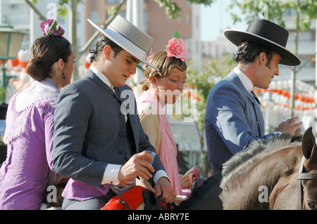 Riders in traditional dress at the April Fair Seville Andalusia Spain - Stock Photo
