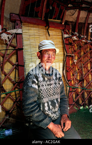 Kyrgyz nomad following a conversation inside his yurt at Tash Rabat in Kyrgyzstan. - Stock Photo