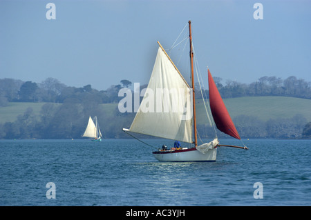 A traditional oyster dredger sailing boat at work in Carrick Roads in the Fal estuary Cornwall England - Stock Photo