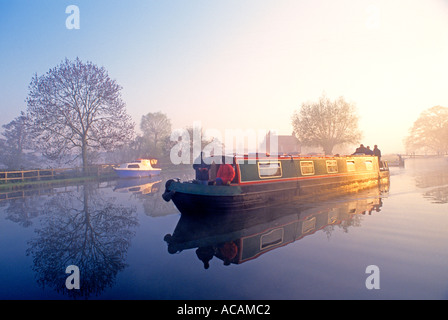 Narrowboat Barge River Wey Traditional holiday hire narrowboat leaving Papercourt Lock on a misty still autumn sunrise - Stock Photo
