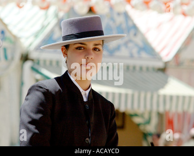 Portrait of a young woman in a riding habit at the April Fair Seville Andalusia Spain  - Stock Photo