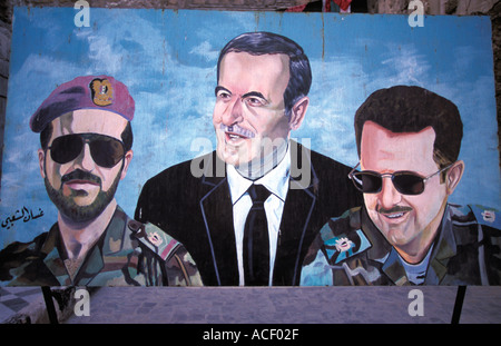 Propaganda poster showing former President Hafez Assad and sons, Damascus, Syria. - Stock Photo
