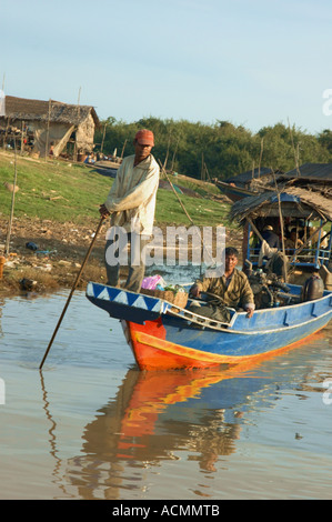 Two men in a boat - Stock Photo