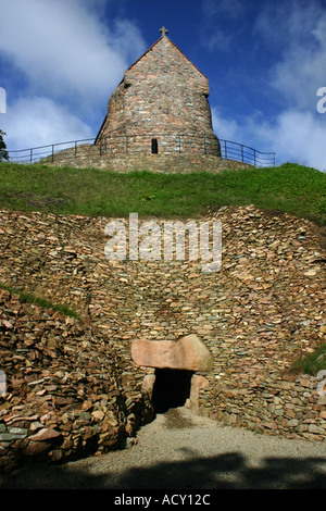 La Hougue Bie Grouville Jersey Entrance to the Neolithic Dolmen 6000 years old with Medieval Chapel atop - Stock Photo