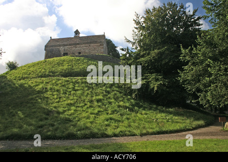 La Hougue Bie Grouville Jersey Neolithic Dolmen 6000 years old with Medieval Chapel atop - Stock Photo