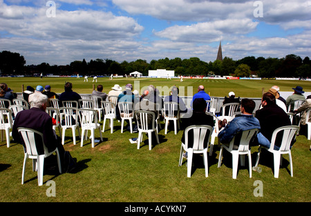 Spectators watch Sussex v Middlesex cricket match at the picturesque Cricketfields ground in Horsham West Sussex - Stock Photo