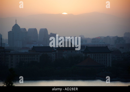sunset over Lake Beihai and the western hills Beijing China - Stock Photo