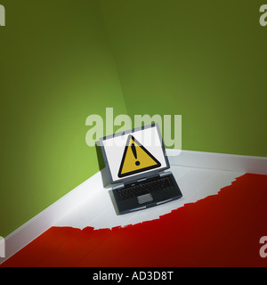 LAP TOP COMPUTER TRAPPED INTO CORNER OF ROOM BY FRESH WET PAINT ON FLOOR - Stock Photo