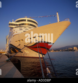 Cruise Ship 'AIDA Diva' at berth with the historic 'Porto Pi' lighthouse in the background in the Port of Palma - Stock Photo