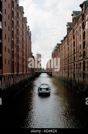 Barge on a canal, Speicherstadt, Hamburg, Germany - Stock Photo