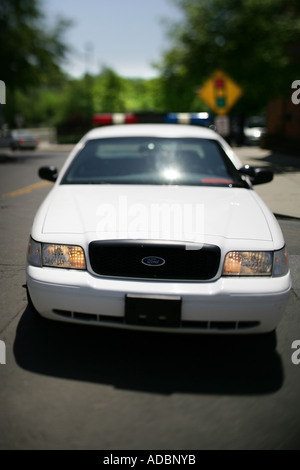 Police car with lights on - Stock Photo
