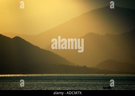 Sunset over Ninh Van Bay from Evason Hideaway at Ana Mandara - Stock Photo