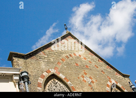 Corbelling and decorative brickwork used on a brick gable - Stock Photo