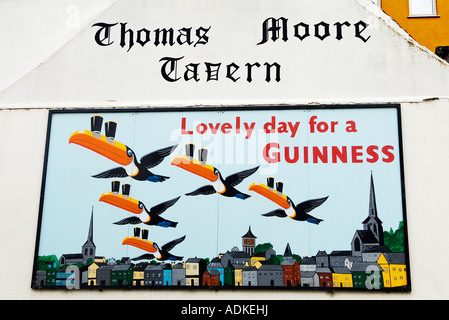 Poet and balladeer Thomas Moore is regarded as Ireland's national bard. Wexford city skyline pub wall Guinness sign, - Stock Photo