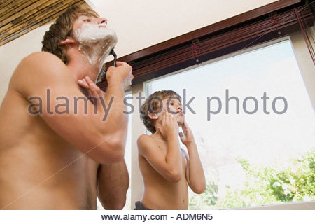 Father and son shaving - Stock Photo