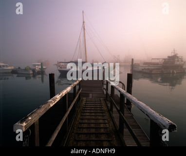Misty morning over Yarmouth harbour, Yarmouth, Isle of Wight, England, UK - Stock Photo