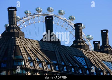 British Airways London Eye seen above rooftops England United Kingdom - Stock Photo