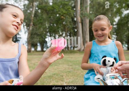 Girls having a tea party - Stock Photo