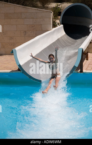 Stock Photo of Happy Young 12 Yo Girl in Bikini On Water Slide - Stock Photo