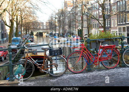 Traditional pedal bicycle on canal bridge in Amsterdam Holland - Stock Photo