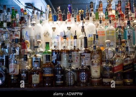 Whiskey and spirit bottles lined up along bar Georgetown Washington DC USA - Stock Photo