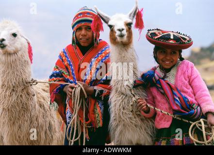 Peruvian children with llamas Peru South America - Stock Photo