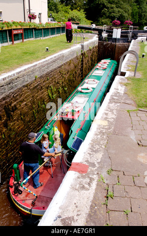 Narrowboat in Brynich Lock on the Monmouthshire and Brecon Canal near Llanfrynach Powys South Wales UK - Stock Photo