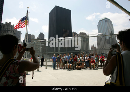 School class takes a group photo in front of Ground Zero New York City - Stock Photo