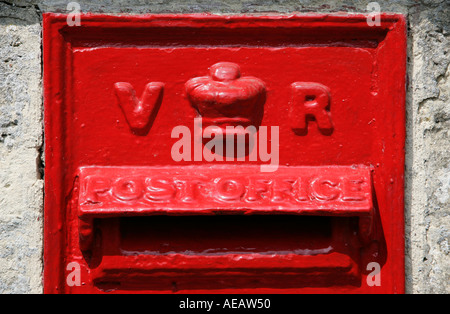 Wall Mounted Post Box showing the cipher VR for the reign of Queen Victoria - Stock Photo
