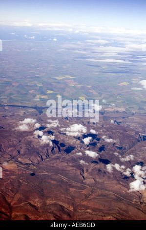 Cloud formations over South African escarpment from the air showing rugged terrain and the Great Rift Valley. - Stock Photo