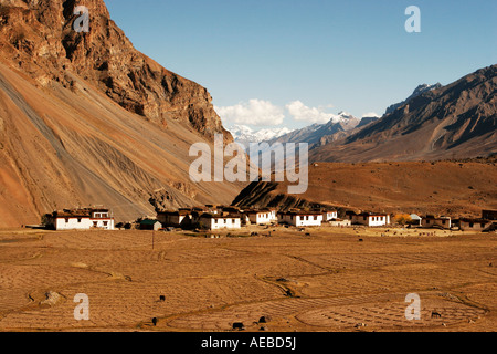 Pictorial View of village Losar and snow-clad mountains at the backdrop in Spiti Valley, Kaza Himachal Pradesh India - Stock Photo