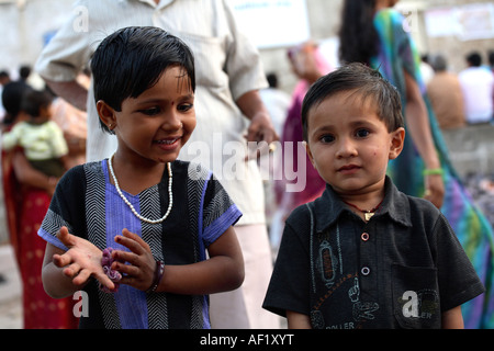 Indian child outside Dwarkanath Temple, Dwarka, Gujarat, India - Stock Photo