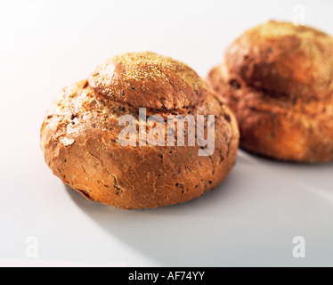 Two granary loaves on a white background - Stock Photo