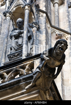 Gargoyle on facade of St Vitus Cathedral, within the grounds of Prague Castle, Czech Republic. - Stock Photo