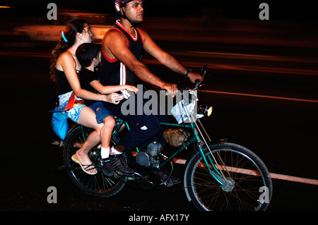 Cuba Havana Habana Vieja Malecon boulevard a family cruising on a motorbike - Stock Photo