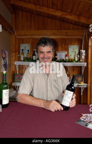 Wine Merchant with Bottle of Wine Gastronomy Festival Budapest Hungary Europe - Stock Photo