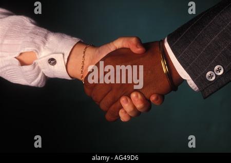 Handshake betwwn white female and black man 1795 - Stock Photo