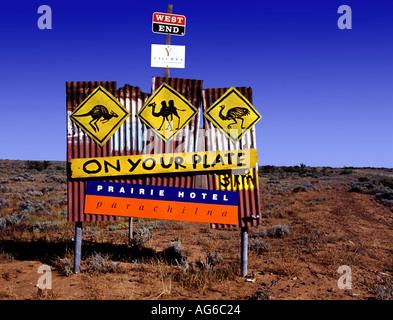 A roadside restaurant sign advertising the Prairie Hotel serving local game near Parachilna in South Australia - Stock Photo